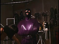 Lesbians perform hardcore S&M with masks and latex