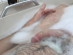 mother and son in bathtub