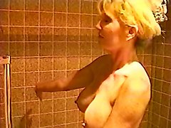 busty blond grandma plays with her wet pussy in shower