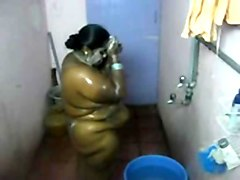 indians bathing in public bathroom