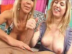 milf shows younger girl how to give a good