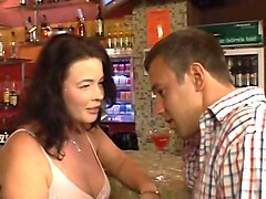 mature woman flashing shaved pussy at public bar
