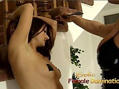 muscly dominatrix takes it out on a hot brunette at home